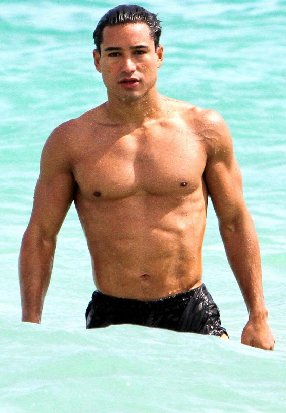 The Libra with shirtless muscular body on the beach